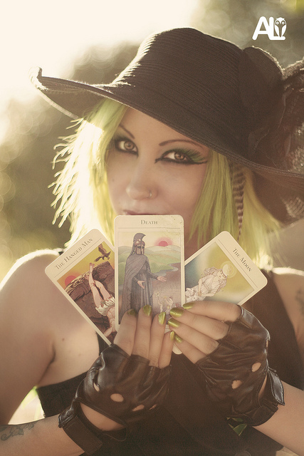 beautiful, black, cards, cemetary, death, eyes, girl, graveyard, green, halloween, hat, hot, leather, model, nail polish, nails, nose ring, pierced, piercing, sexy, tarot, tarot cards, tattoo, the hanged man, the moon, witch, woman
