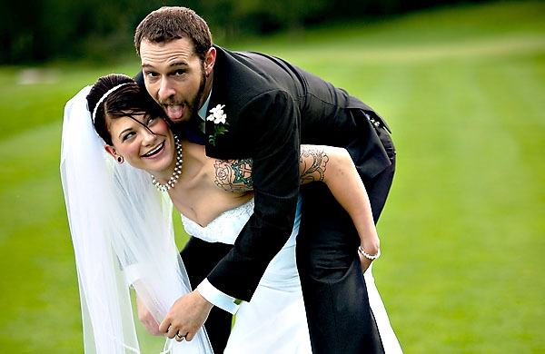 bride, cute, groom, happy, love, marriage, piggy back ride, tattoos, tuxedo, wedding, wedding party