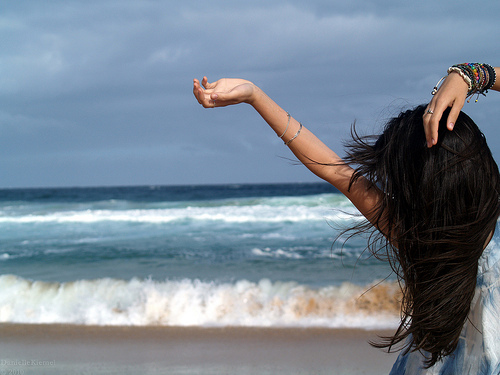 Girl Hair Blowing in the Wind at the Beach