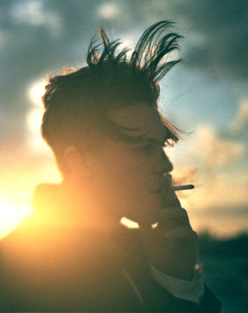 beautiful, boy, cigarette, clouds, cute boy, hair, model, sky, smoke, smoking, sun, sunlight, wind