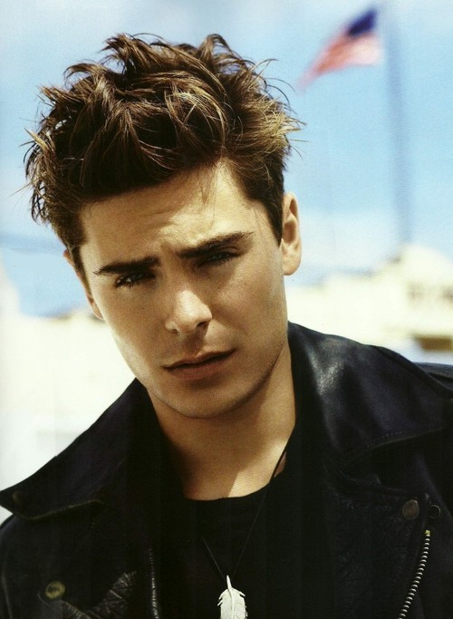 Picture of Zac Efron with a Shaggy hairstyle lifted up and tousled