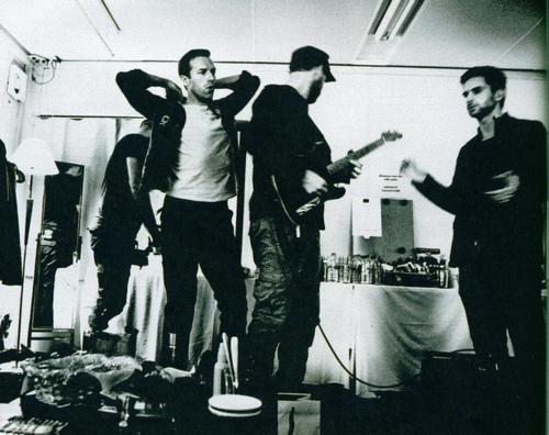 chris martin, coldplay, guy berryman, jonny buckland, will champion