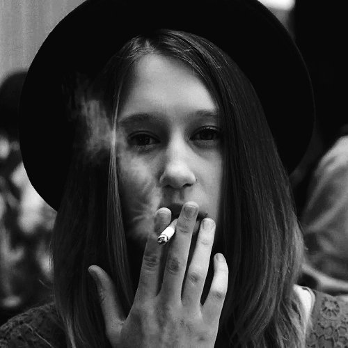 Taissa Farmiga smoking a cigarette (or weed)