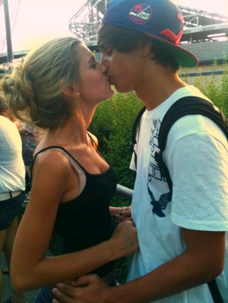 Teen Couple Kissing On The 15
