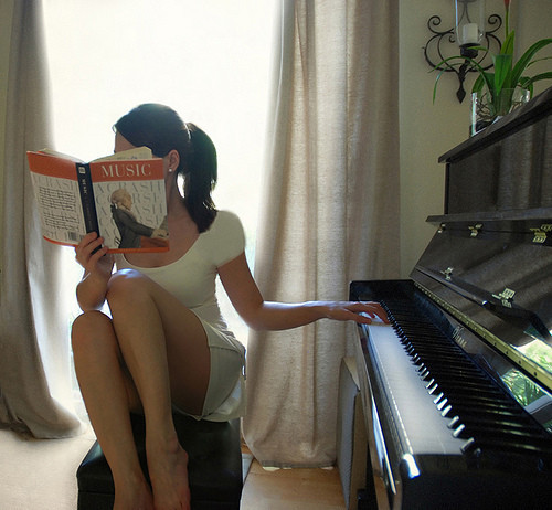 book, girl, music, piano, playing piano, readdin a book