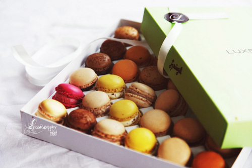 Beautiful box filled with colored macaron cookies