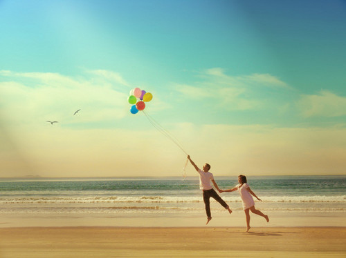 balloons, black, blue, boy, fly, girl, hair, happy, pink, red, sand, sky, water, white, yellow