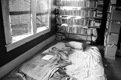 bed, bedroom, black and white, books, floor