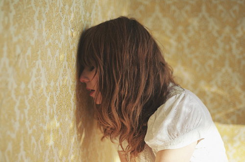 blonde, closed eyes, curly hair, girl, ophidiophobic, pretty, sad, shadow, wall, wallpaper, white shirt, yellow