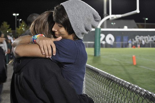 boy, couple, cute, cute couple, football game, girl, happy, hugging, love